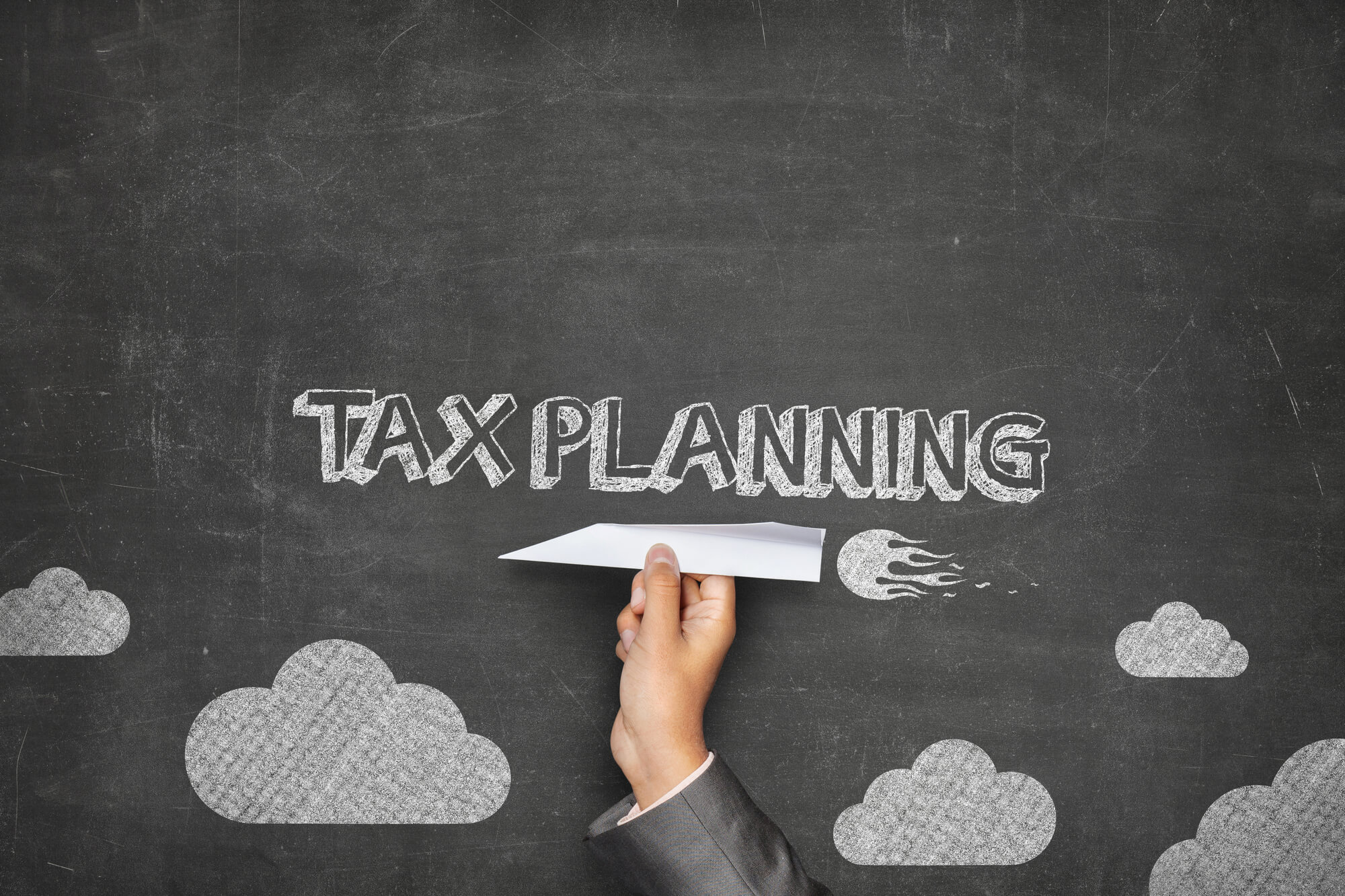 CPA in Pembroke Pines does tax planning on a chalkboard